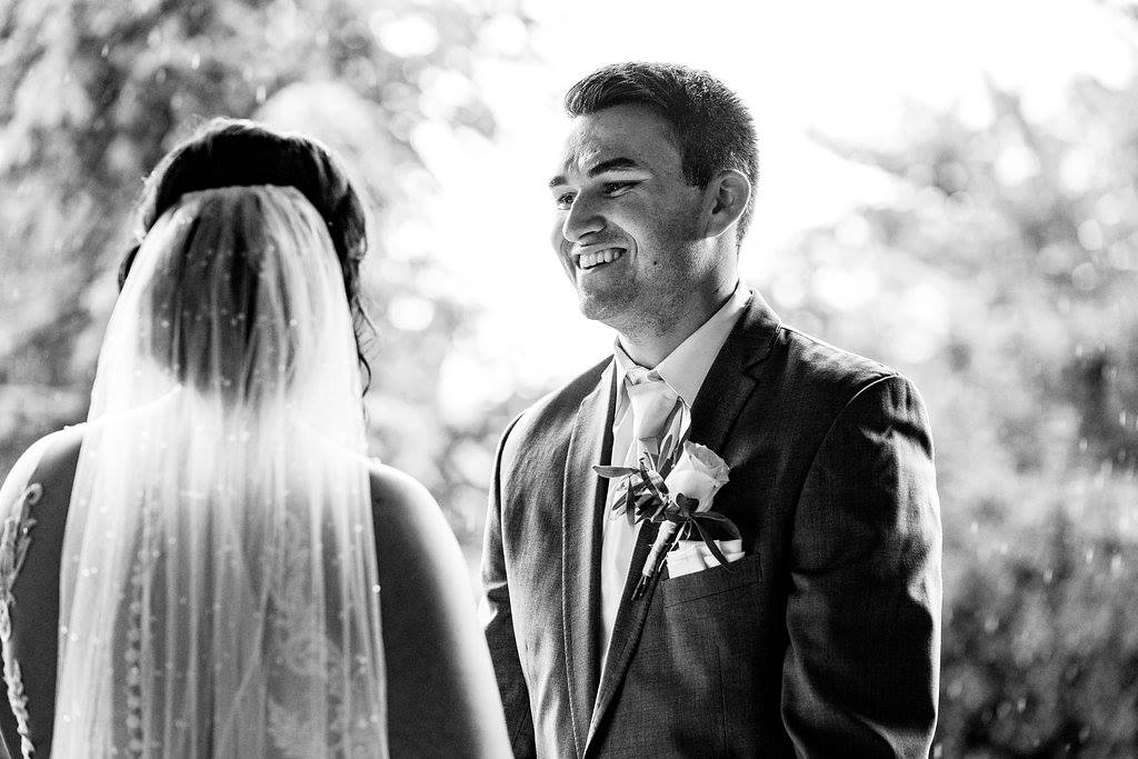 Groom, Justin smiling at his bride, Jensen!
